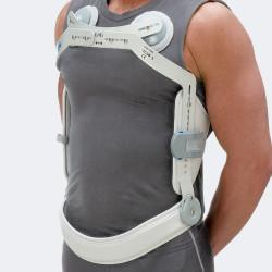TC38 Busto iperestensore a tre punti con supporti clavicolari e banda pelvica basculante (bloccabile/sbloccabile)